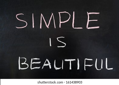 Simple is beautiful words written on blackboard