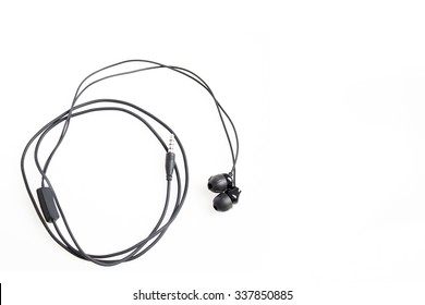 Simple Black Twisted Headphones On White Background