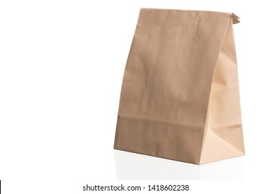 simple brown paper bag for lunch or food isolated on white background with copy space
