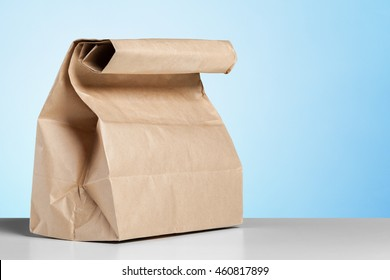 simple brown paper bag for lunch or food on table