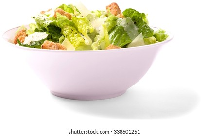 simple Caesar salad with croutons in a bowl - Isolated
