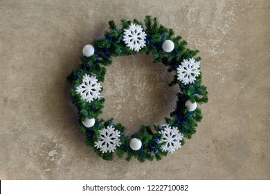 Simple Christmas wreath with snowflakes. Holiday symbol