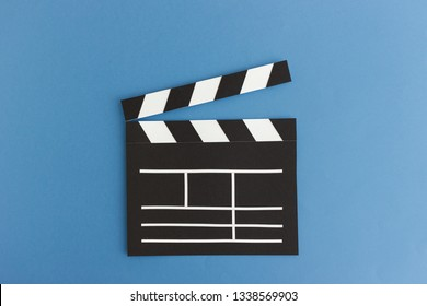 Simple clear paper clapperboard for movie scenes shooting on blue background