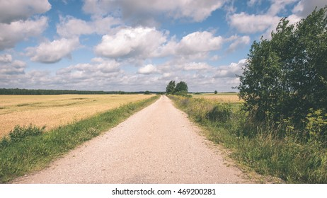 simple country road in summer at countryside with trees around - vintage film effect