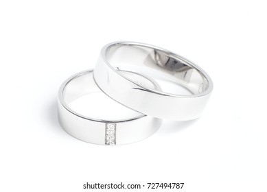 Simple delicate wedding rings made of white gold, with diamonds for her.