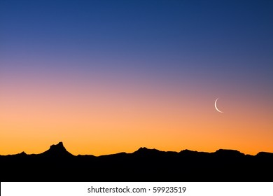 A simple desert landscape after sunset with plenty of copy space.