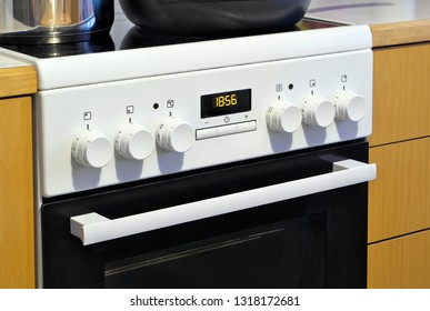 Simple electric range in kitchen at home.