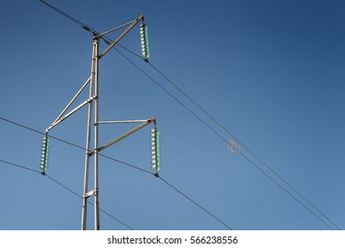Simple electricity pylon with wires and insulators
