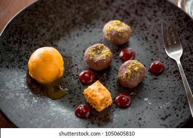 simple and elegant fine dining cuisine, chocolate dessert with mango ice cream