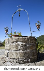 A simple and elegant stone well in a garden