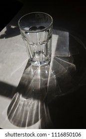 A simple experiment showing light being refracted as it passes through a glass, bending the light waves and changing its direction and speed as it passes through the glass medium