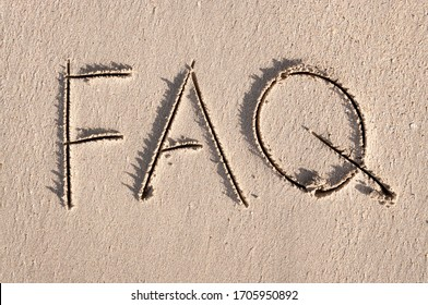 Simple FAQ message, the abbreviation for Frequently Asked Questions, handwritten outdoors on clean smooth sand beach