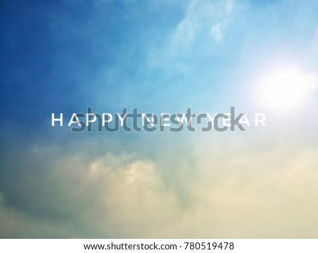 simple font of happy new year on heaven clear blue sky white cloud and sun