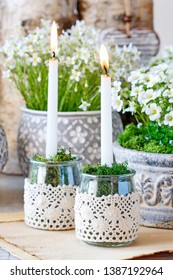 Simple glass jars transformed into a beautiful candle holders decorated with lace and moss.