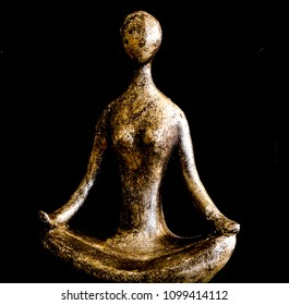 Simple Gold and Silver Body Form in the Yoga Lotus Position with black background
