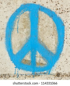 Simple graffity on a concrete wall, a peace sign