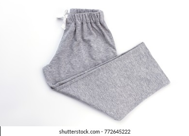 Simple gray melange boys' pants on white. Waistband and drawstring. Comfy pajama bottom for night rest.