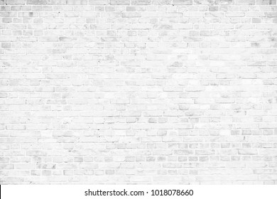 Simple grungy white brick wall as seamless pattern texture background.
