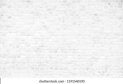 Simple grungy white brick wall with light gray shades seamless pattern surface texture background.