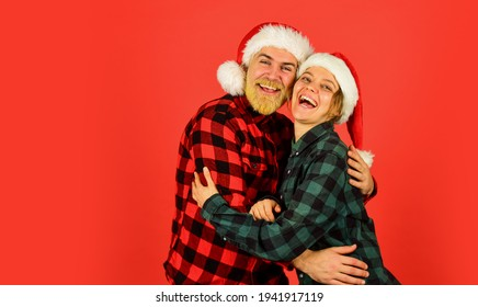 Simple happiness. Winter entertainment. Santa Claus style. Having fun. Couple in love new year eve. Christmas time. Wear Santa hat. Man and woman christmas holiday celebration. Christmas party