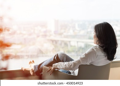 Simple healthy living lifestyle menopause aged Asian woman take a rest relaxing with self awareness, peace of mind, mental health balance care free, do nothing at home or in luxury hotel guest room