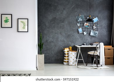 Simple home office with grey wall, desk and chair