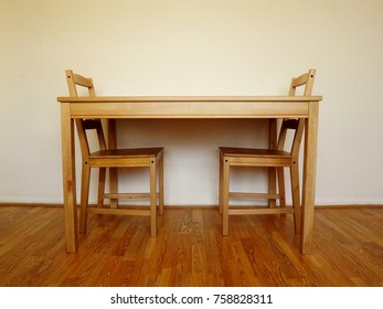 Simple interior design scene with two wooden chairs and a table on wood block floor