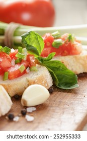 simple italian bruschetta with tomato and chives