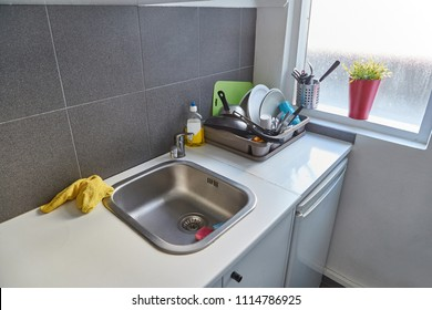 Simple kitchen with sink and dishes