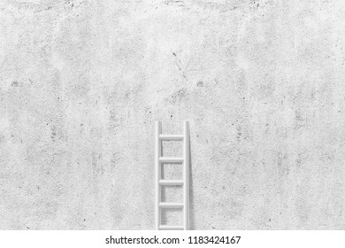 Simple ladder leaning against white concrete wall background