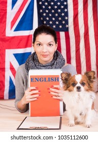 Simple learning language concept. English even for dog. Young woman and her dog learning english language.