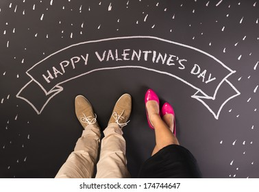 Simple love concept with feet and chalk drawn symbols. Happy valentines card.