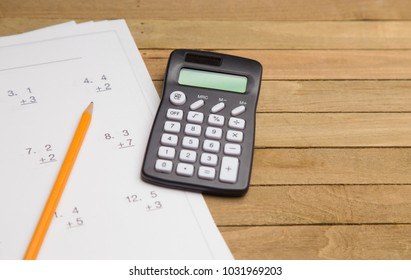 Simple Math Worksheet on a Wooden Table