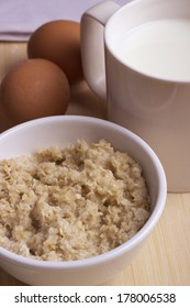 Simple natural breakfast: milk, oatmeal and eggs