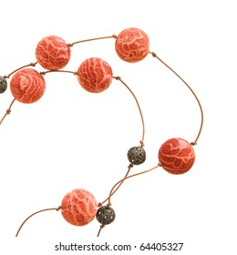 simple necklace - sponge coral and lacy metal beads on a thin leather cord, isolated on white