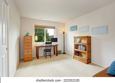 Simple office room interior with wooden desk, storage cabinet and bookshelf