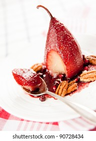 Simple Paleo Style Dessert Pear Poached in Pomegranate Juice Served with Nuts and Seeds
