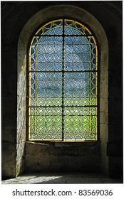 Simple patterned stained glass window in a French abbey.
