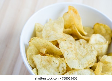 Simple potato chips on white background