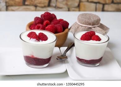 Simple raspberry yogurt and jam parfait in two glass cups