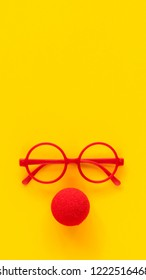Simple red plastic glasses frames and red foam clown nose. Add to and build your own silly, goofy face. Isolated.