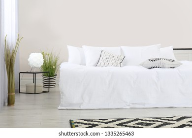 Simple room interior with large comfortable bed