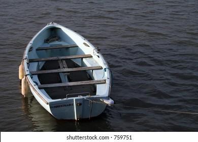 A simple rowing boat moored in Edinburgh.