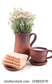Simple rural breakfast set decorated with chamomile and burlap overlay
