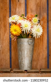 Simple, rustic country style fall autumn Thanksgiving season floral dahlia bouquet in galvanized metal vase home decorations