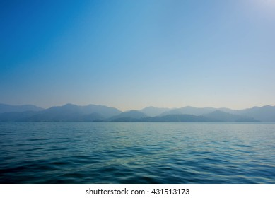Simple sea and mountain, Blue Sea and shade of mountain as defocused on sea. And nothing on sea. no people on sea.