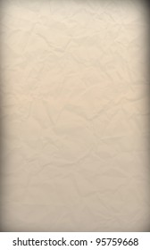 A simple sepia colored crumpled paper texture background.