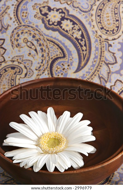 simple spa scene with paisley background