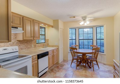 Simple style kitchen with round eat in table.