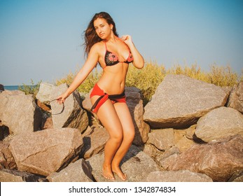 Simple tan arabic girl from small town, plus size young lady at nature. Portrait of voluptuous young woman posing sensually on ocean  background